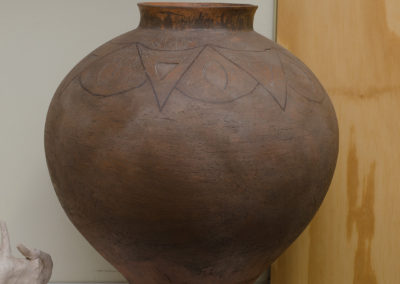 Terra-cotta with black inlay pattern