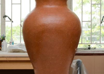 Set of voluptuous terra-cotta pots (glazed)